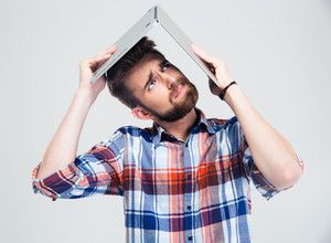 man-holding-laptop-on-his-head-like-roof-of-house_thumb.jpg