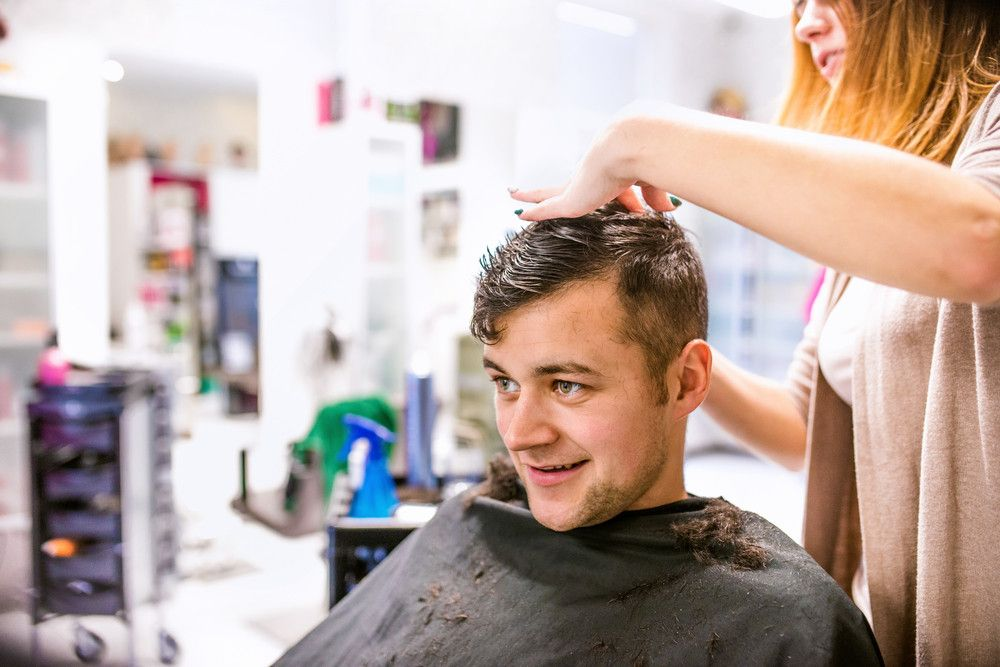 graphicstock-unrecognizable-professional-hairdresser-making-new-haircut-to-her-handsome-client-barber-at-work-man-at-barbershop_rOrTIBSzb_PMNW.jpg