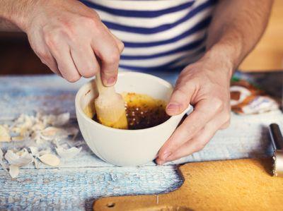 graphicstock-unrecognizable-man-in-a-domestic-kitchen-preparing-sauce_S0WzDXsp--_PMNW.jpg