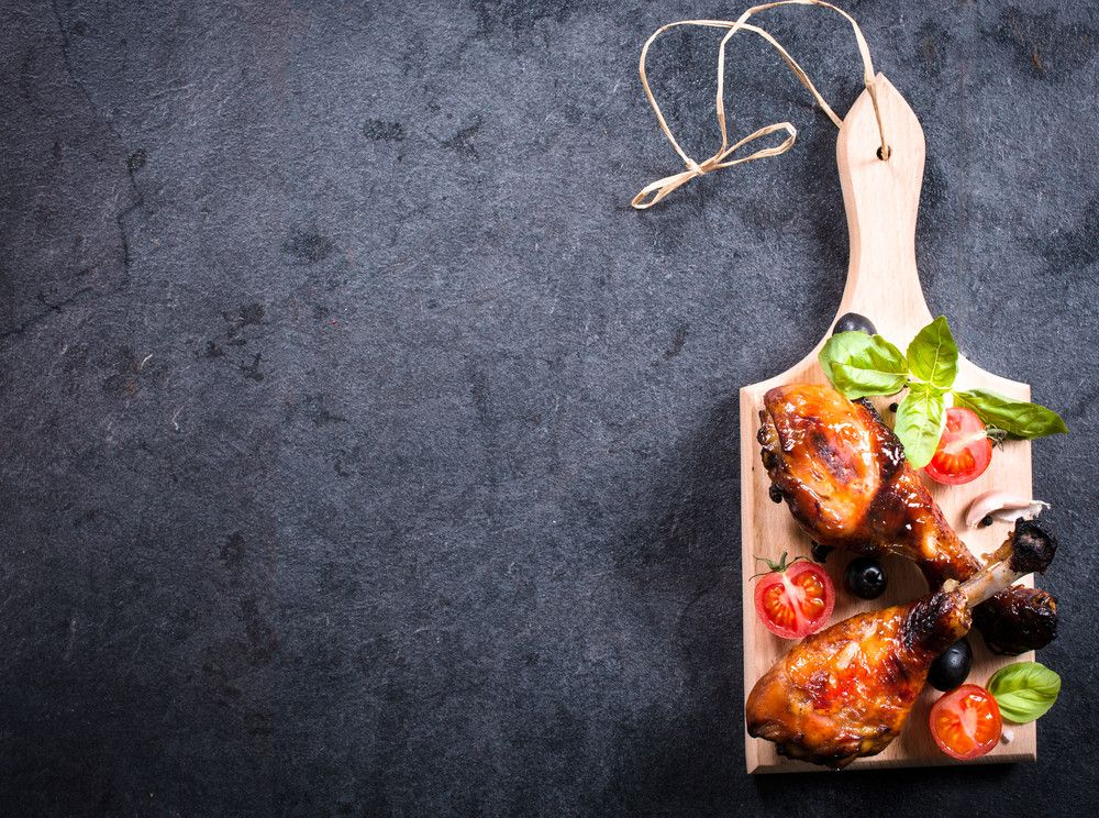 chicken-drumsticks-on-wooden-board__PMNW.jpg